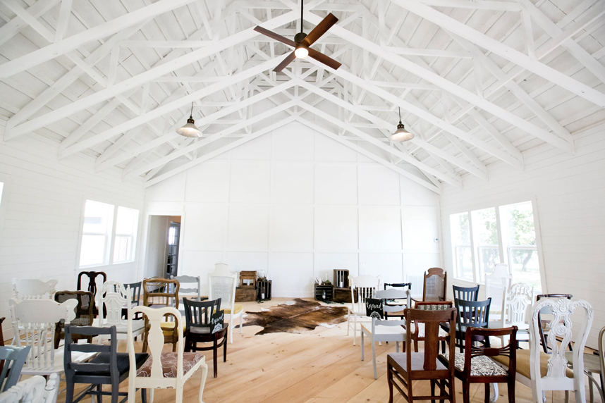 The Farmhouse At Grroots Vintage Events With All White Interior Cathedral Ceilings Lighting And Pine Wood Plank Flooring