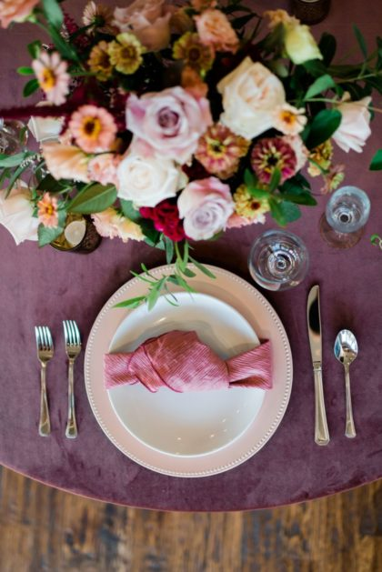 mauve table setting at glass veranda wedding venue