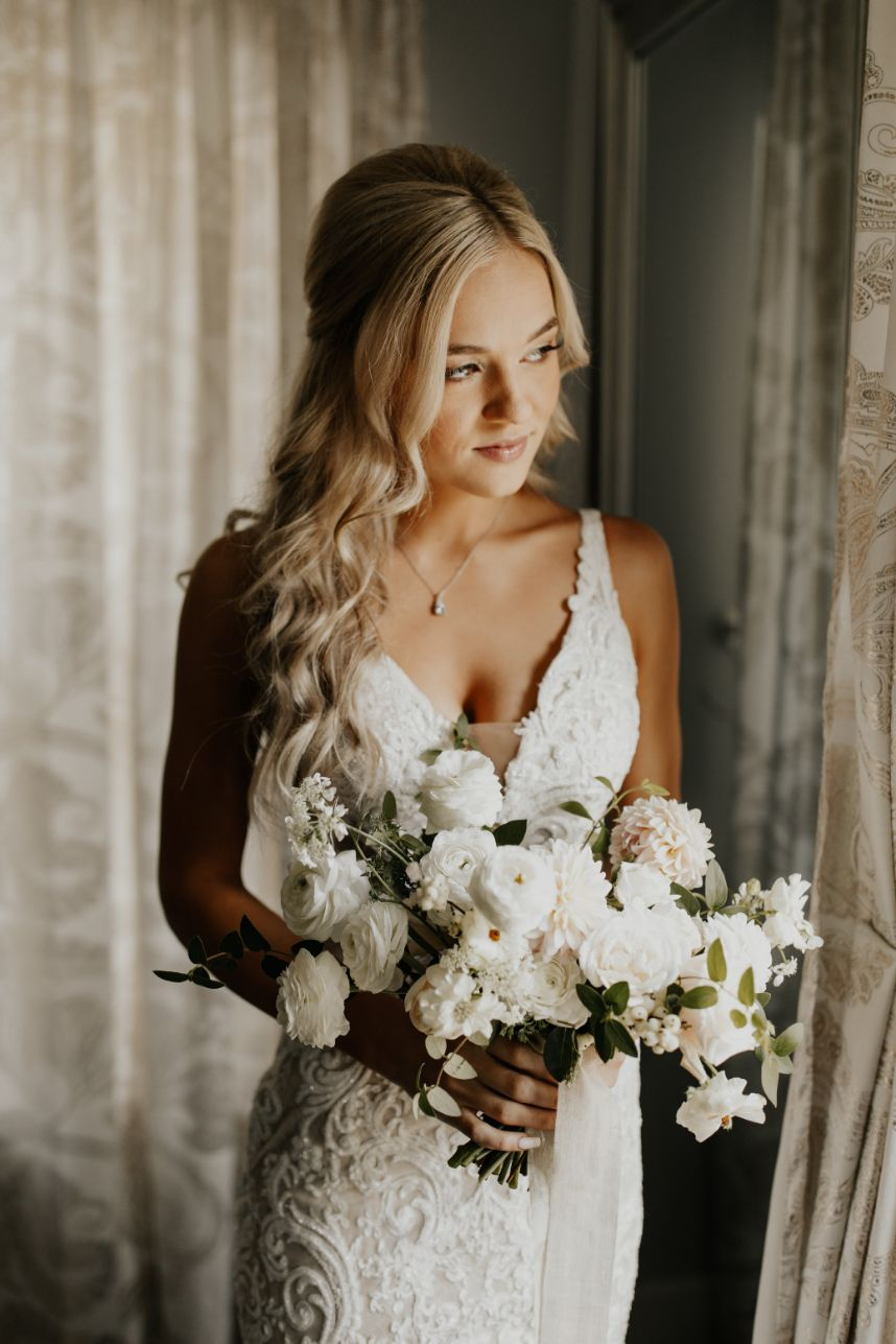 bride looking out window | how to create a shot list for your wedding photographer